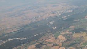 Aero filming, land surface through overcast. Milan, Italy. 2018-09-25 stock video