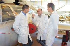 Aero mechanicians students posing with teacher near fouga magister Royalty Free Stock Image