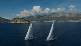 Aero shooting of two yachts in the open sea.  stock video