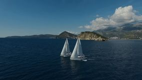 Aero shooting of two yachts in the open sea.  stock video footage