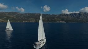 Aero shooting of two yachts in the open sea.  stock footage