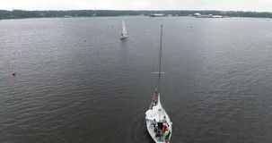 Aero shooting of two yachts in the open lake. Aero shooting of two yachts in the open sea 4K stock footage