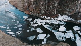 Aero shot. Huge pieces of ice on the river during the ice debacle. The beginning of spring in russia Siberia the Ural Mountains stock video