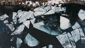 Aero shot. Huge pieces of ice on the river during the ice debacle. The beginning of spring in russia Siberia the Ural Mountains stock footage