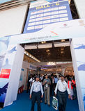 Aero Show 2011. BANGALORE, INDIA - FEBRUARY 11: Visitors leave a hall at the Aero Show on February 11 in Bangalore, India. The Aero Show is one of the largest in stock image