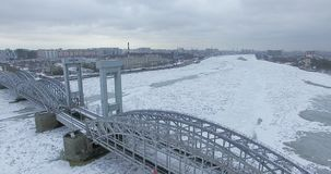 Aerial view. Flying along the river Neva in winter overcast cold weather. Bridge over the river Petersburg. The height of the bird stock photos