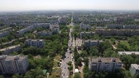 Aero view of modern city, camera is flying over houses, parks and roads. Aero view of modern city in summer day, camera is flying over houses, parks and roads stock video footage