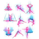 Aero yoga watercolor icons. Vector illustration. Aero yoga watercolor icons. Women performing asanas in a hanging hammock. Logo design. Vector illustration Stock Images