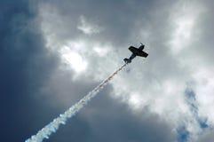 Aerobatic Airplane. Sukhoi Aerobatic airplane with smoke trail Stock Photo
