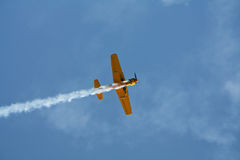 Aerobatic airplane flying Stock Images