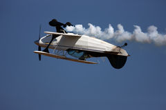 Aerobatic airplane inverted. One aerobatic aeroplane flying upside down during an airshow royalty free stock images