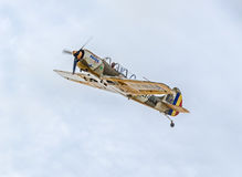 Aerobatic airplane pilot Jurgis Kairys training in the sky of the city. Colored airplane with trace smoke, airbandits, aeroshow Stock Photography