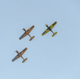 Aerobatic airplane pilots training in the sky of the Bucharest City, Romania. Colored airplane with trace smoke Royalty Free Stock Photo
