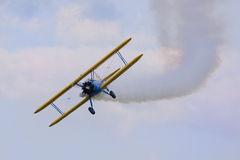 Aerobatic bi plane airplane. Stearman bi plane flying out of a loop Stock Photo
