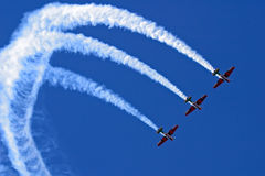 Aerobatic display. Three planes performing a synchronized flying display during an aerobatic show stock photo