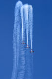 Aerobatic display. Three planes performing a synchronized flying display during an aerobatic show stock images
