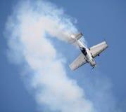 Aerobatic display. Airshow aerobatic display. Piston-engined aircraft with smoke trail royalty free stock photography