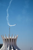 Aerobatic display above Cathedral of Brasilia royalty free stock photos