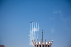 Aerobatic display above Cathedral of Brasilia 2010 stock photos