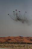 Aerobatic display over the desert Stock Photos