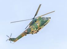 Aerobatic elicopter pilots training in the sky of the city. Puma elicopter, navy, army drill Royalty Free Stock Images