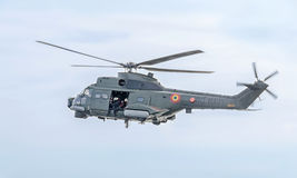 Aerobatic elicopter pilots training in the sky of the city. Puma elicopter, navy drill. Aeroshow Stock Images