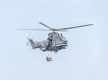 Aerobatic elicopter pilots training in the sky of the city. Puma elicopter, navy drill. Aeroshow Royalty Free Stock Image