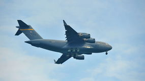 Aerobatic flying display by US Air Force (USAF) C-17 Globemaster III military cargo aircraft at Singapore Airshow. SINGAPORE - FEBRUARY 9: Aerobatic flying Royalty Free Stock Image