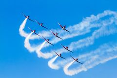 Aerobatic group on the airshow with smoke. Aerobatic group on the airshow, SIAF 2015 - Slovakia - Sliac stock image
