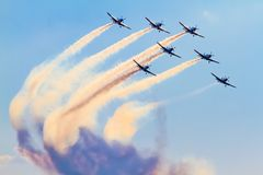 Aerobatic group on the airshow with smoke royalty free stock photography