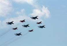 Aerobatic  group on the background of white clouds Stock Photo