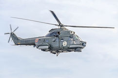 Aerobatic helicopter pilots training in the sky of the city. Puma elicopter, navy drill. Aeroshow Stock Images