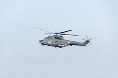 Aerobatic helicopter pilots training in the sky of the city. Puma elicopter, navy drill. Aeroshow Stock Photography