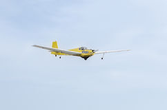Aerobatic motorplane (sailplane) pilot training in the sky of the city. ICA IS-28, aeroshow Royalty Free Stock Image