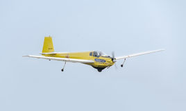 Aerobatic motorplane (sailplane) pilot training in the sky of the city. ICA IS-28, aeroshow Royalty Free Stock Photo