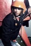 Aerobatic pilot in the orange helmet Royalty Free Stock Photo
