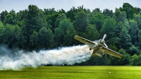 Jurgis Kairis on Su-31 during display in Goraszka in Poland. Aerobatic pilot perform low pass in Goraszka air sho in 2007 in Poland. There is a white contrail royalty free stock images