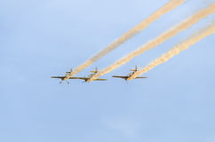Aerobatic pilots training in the blue sky, airplanes with colored trace smoke Royalty Free Stock Photos