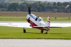 Aerobatic plane on runway. Aerobatic plane on aircraft preparing for take off Stock Photos
