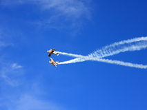Aerobatic show. Couple plane during airshow playing with smoke Royalty Free Stock Photo