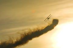 Aerobatic stearman. Boeing stearman aerobatic bi plane performing aerobatics at sunset Stock Photography