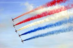 Aerobatic team. aeroplanes flying in a show. An event or show of aerobatic team aeroplanes flying in the sky Royalty Free Stock Photography