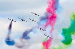 Aerobatic team aircraft fighters trail of smoke in the sky. Royalty Free Stock Images
