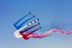 Aerobatic team at airshow. Aerobatic team in the blue sky at airshow Royalty Free Stock Photo