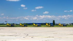 Aerobatic team - Baltic Bees. BUCHAREST, ROMANIA - JUNE 22, 2014: Aircraft aerobatic team Baltic Bees stationary in formation at the largest romanian air show Royalty Free Stock Image
