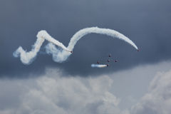 Aerobatic team coming from barrel roll Royalty Free Stock Photo