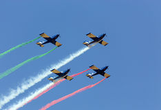 Aerobatic team in formation. Aerobatic team of 4 aircraft flying in formation royalty free stock photography