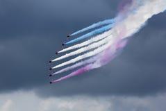 Aerobatic Team gegen drastischen Himmel Stockbild