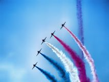 Four military training jet aircraft in aerobatic team. Aerobatic team over Polish sky. Hawk training aircraft in arrow formation making a loop during Radom Air royalty free stock photography