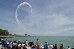 Aerobatic team performing Loop. May be used to advertise for upcoming air and water shows or to advertise for specific aerobatic teams and their aircraft Royalty Free Stock Photo